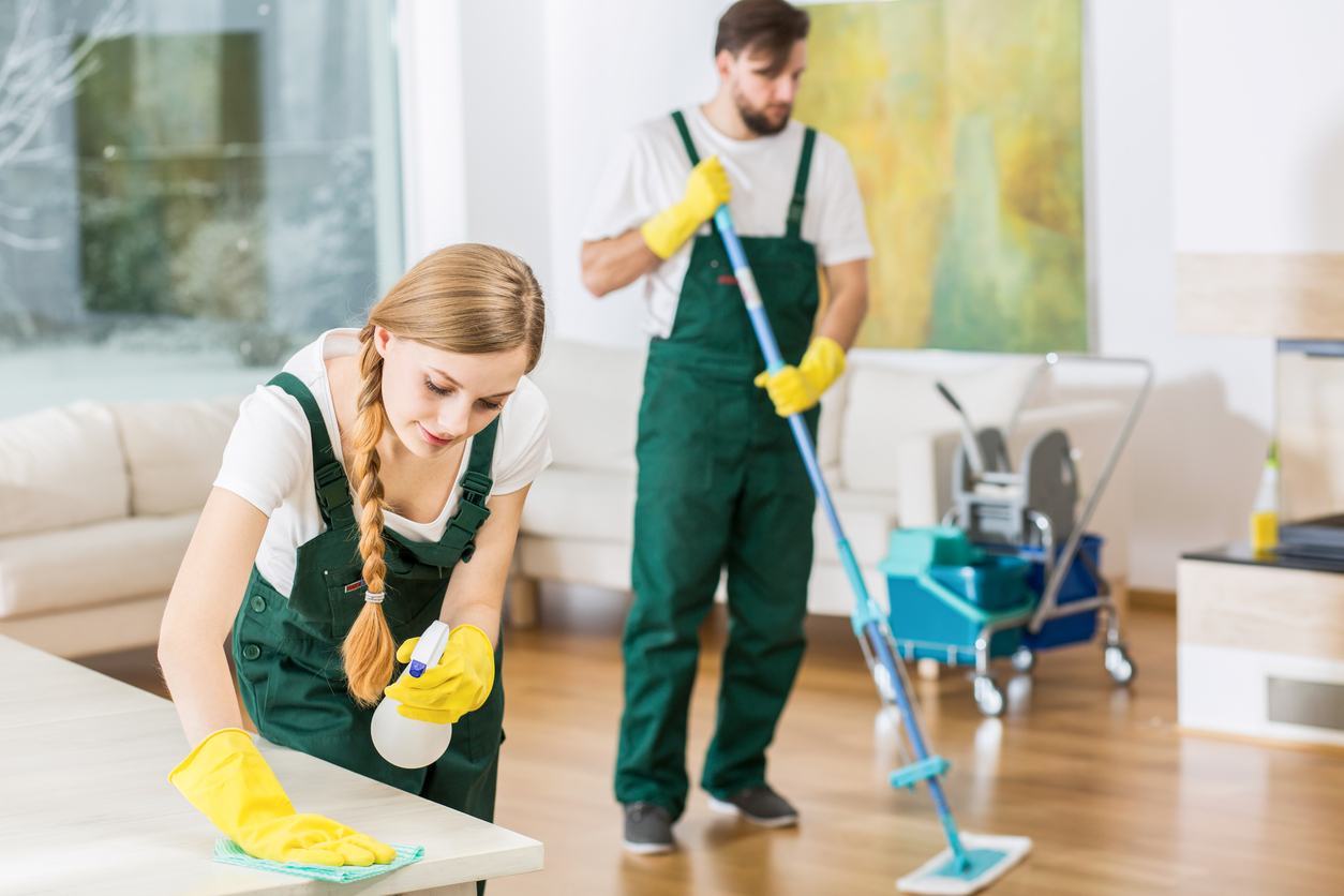 Cleaners putting in order dirty apartment